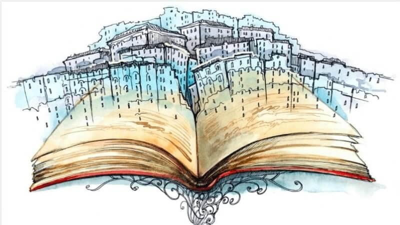 Storie: libro aperto con un paesaggio che ne esce fuori